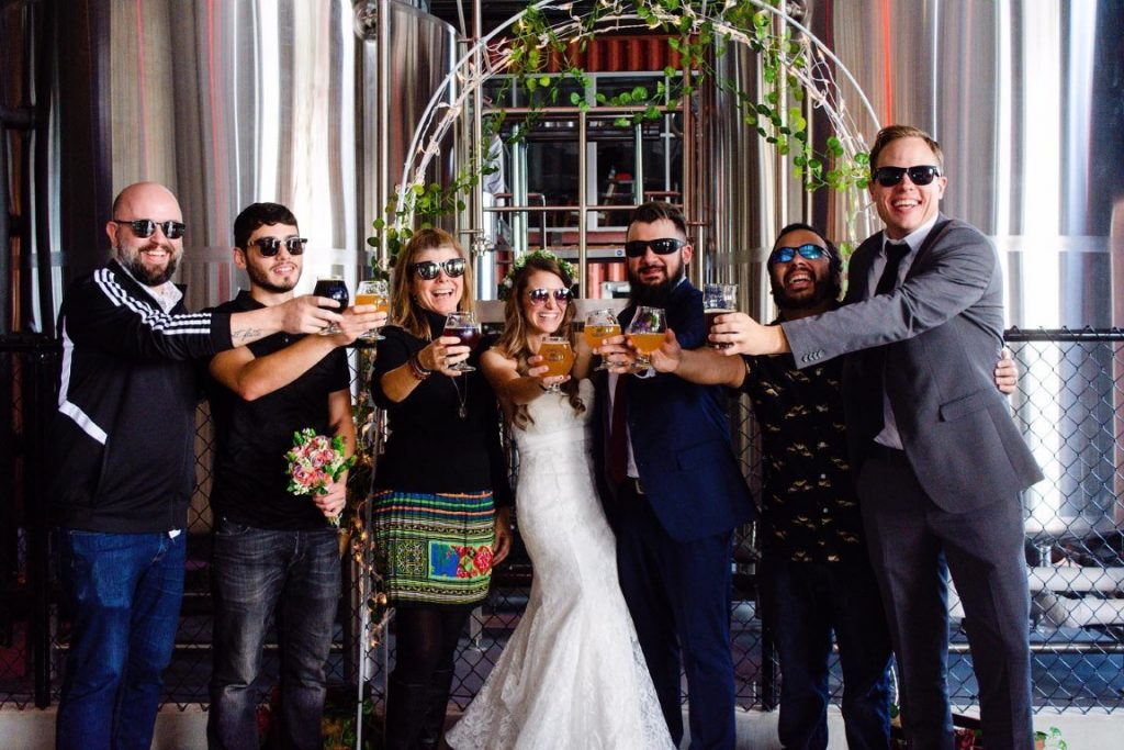 Castle-Church-Brewing-Bridal party cheersing with draft beer in glasses in front of taproom