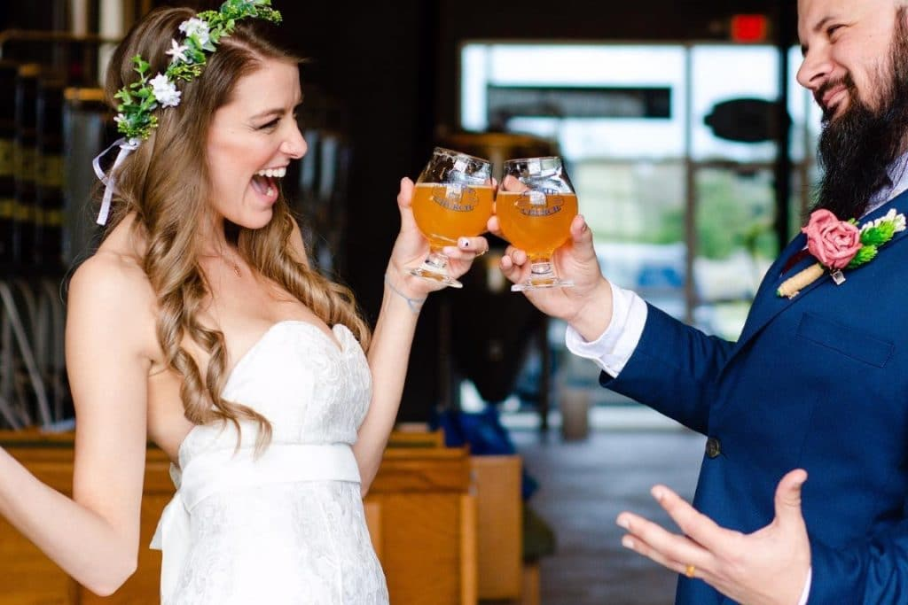 Castle-Church-Brewing-Bride and Groom clinking beer glasses in taproom