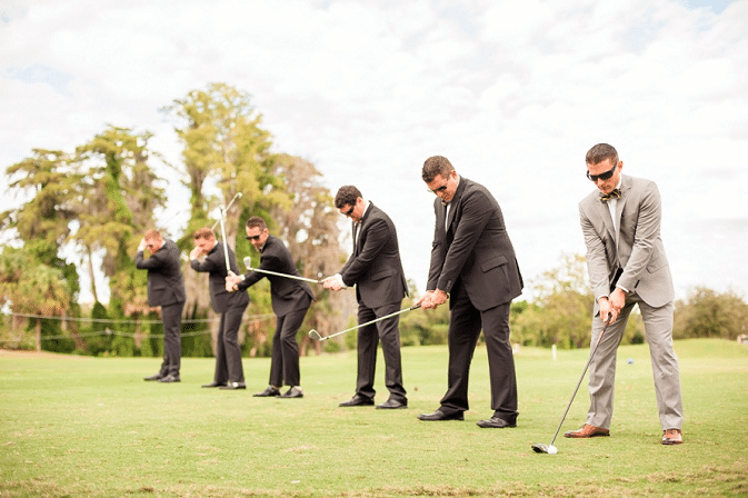 Historic Dubsdread Ballroom - grooms taking shots with golf clubs on golf course