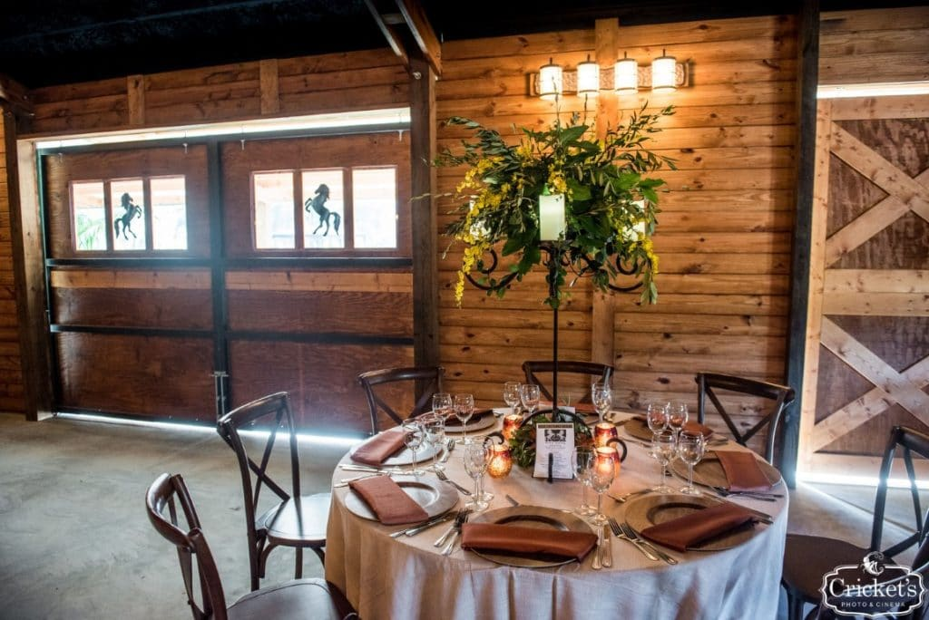 BLB-Hacienda-Inside of barn with tables set up for reception