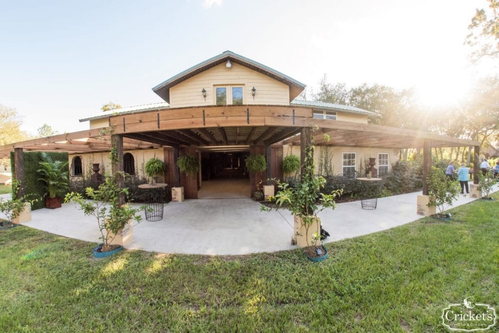 BLB-Hacienda-Other barn entrance with large overhang patio and drive way