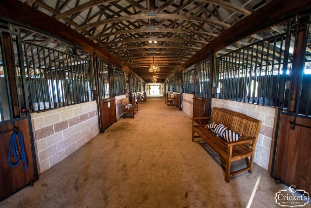 BLB-Hacienda-Long walk thru barn with several horse stalls on either side