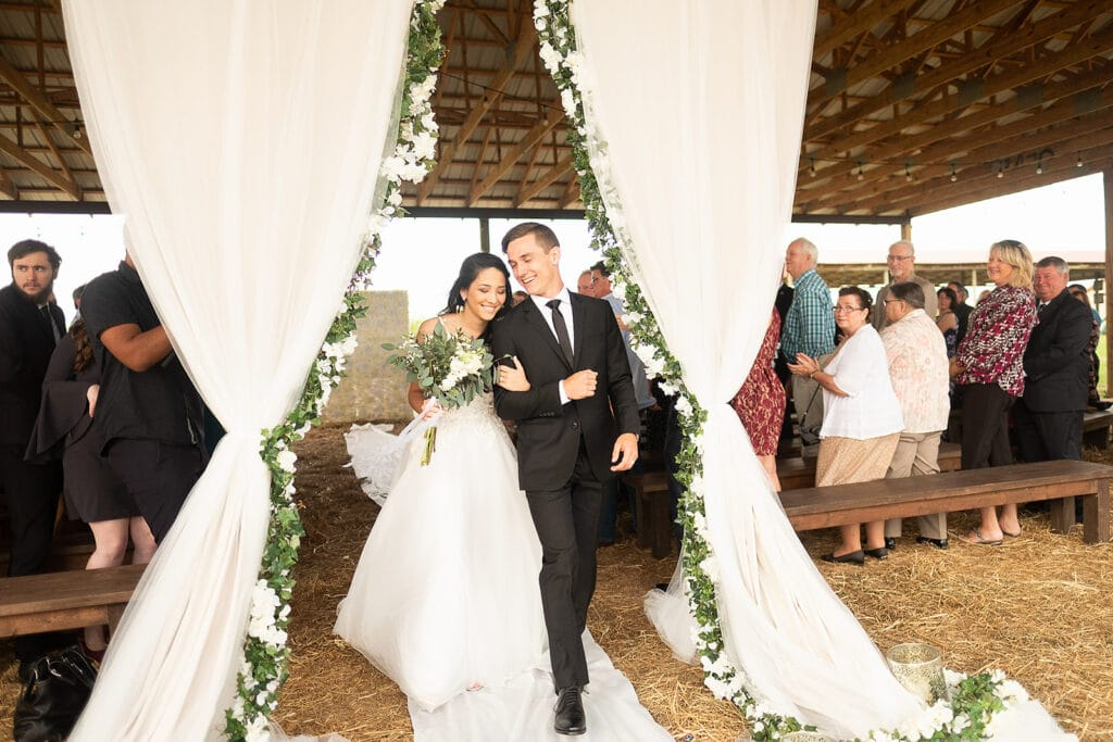 bride and groom exiting wedding ceremony under covered pavilion at Southern Hill Farms