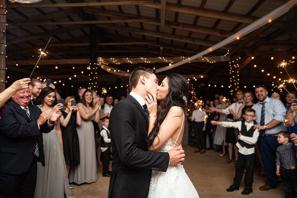 married couple kissing during first dance at their nighttime outdoor wedding reception at Southern Hill Farms