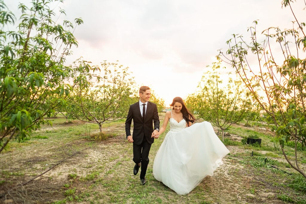 bride and groom walking outside on their wedding day at Southern Hill Farms