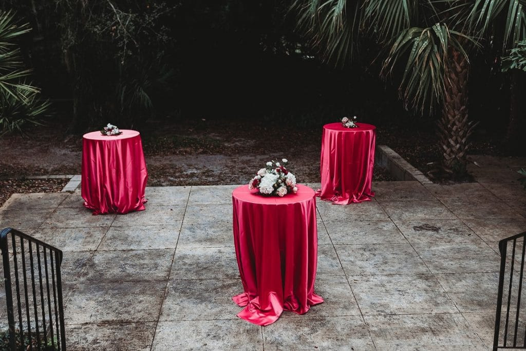 Azalea-Lodge-Mead-Botanical-Garden-High top tables with flower centerpieces on concrete area