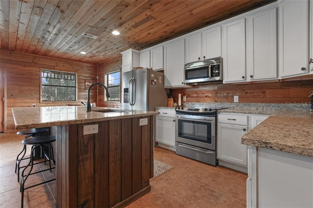 kitchen with white cabinets and wood ceiling