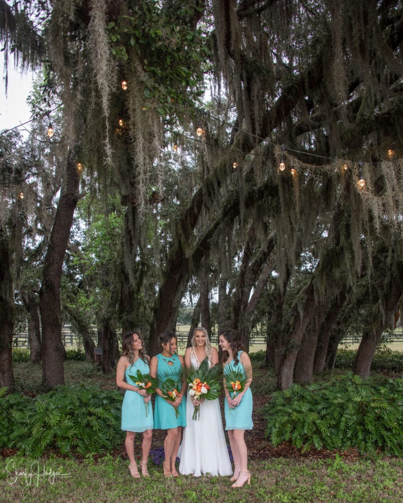 bride with bright flowers and bridesmaids in short blue dresses