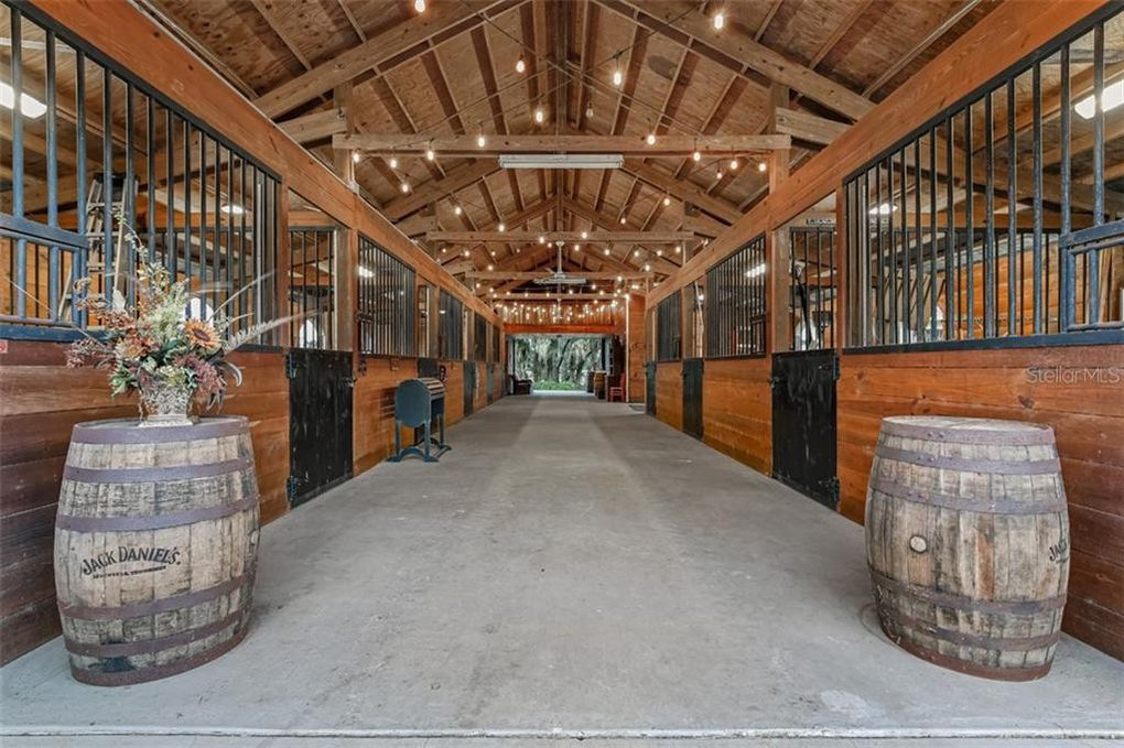 barn stalls with barrels and hanging lights