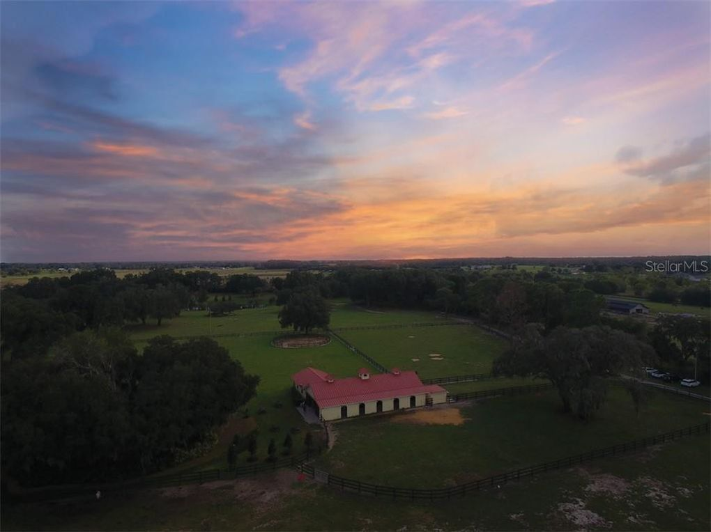 aerial view of farm at sunset