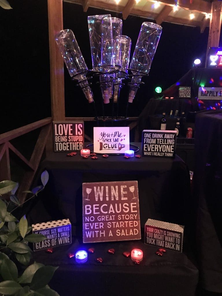 Beck-N-Call-Bartenders-Twinkle bottles and wooden signs at reception