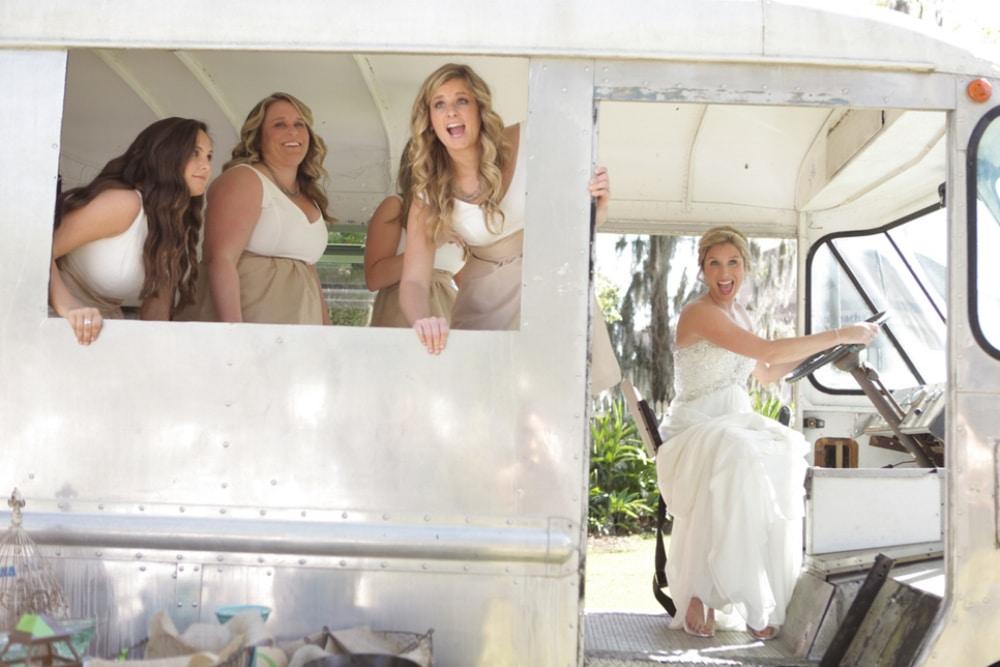 bride and bridesmaids on wedding bus