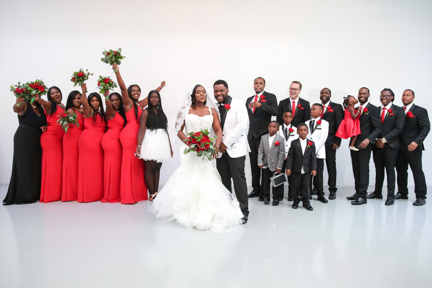 large wedding party posed with couple