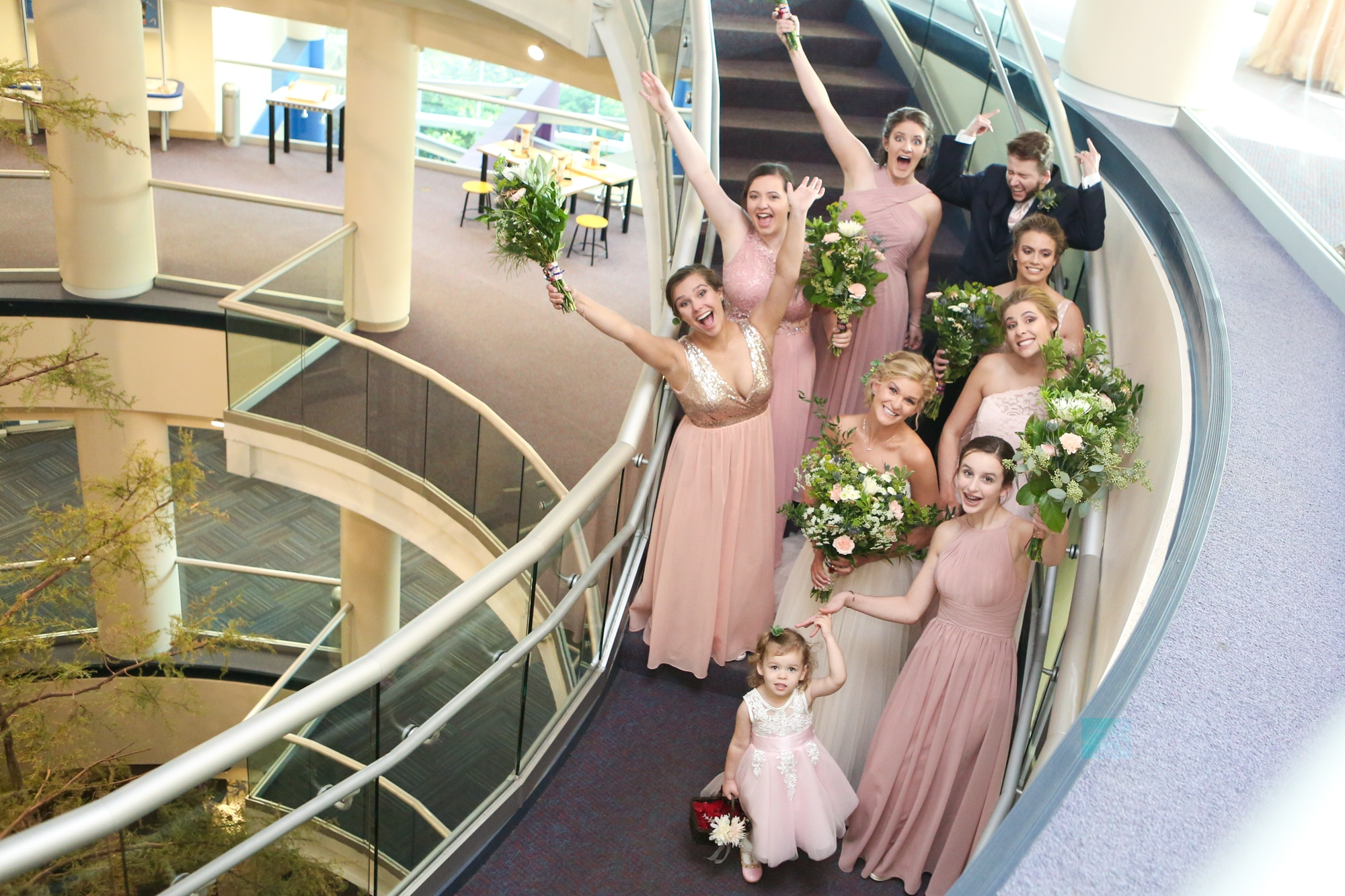 bride and bridesmaids on staircase at the orlando science center wedding party