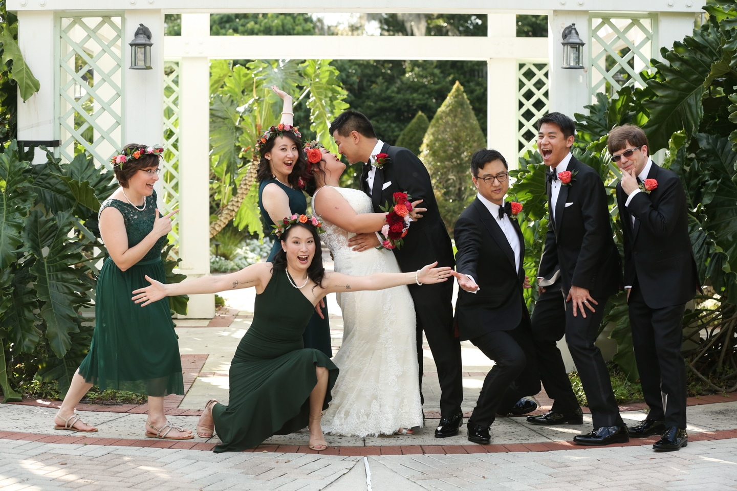 wedding party outside with fun posing