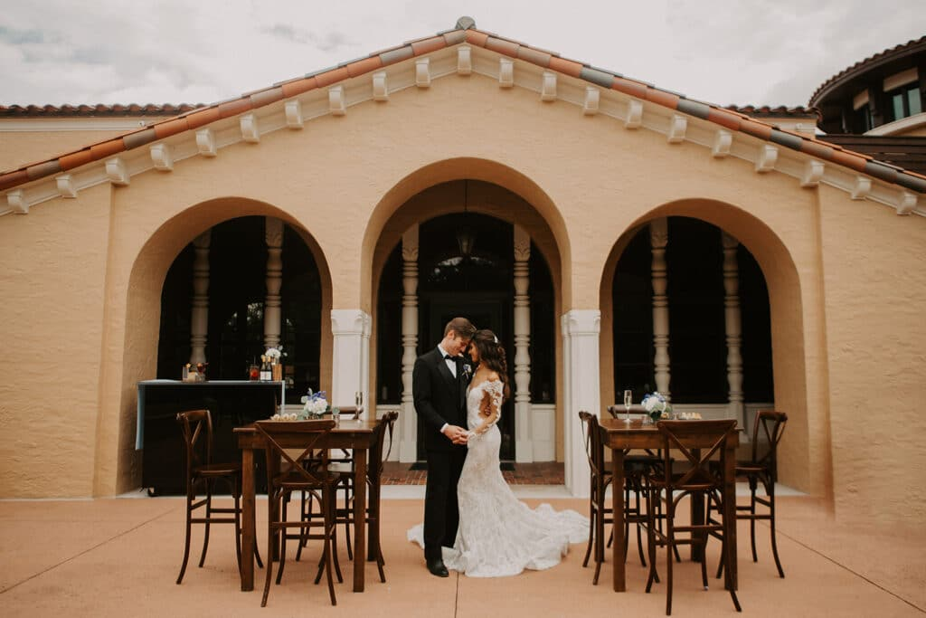 bride and groom dancing between tables at 1885 Events at Rollins College