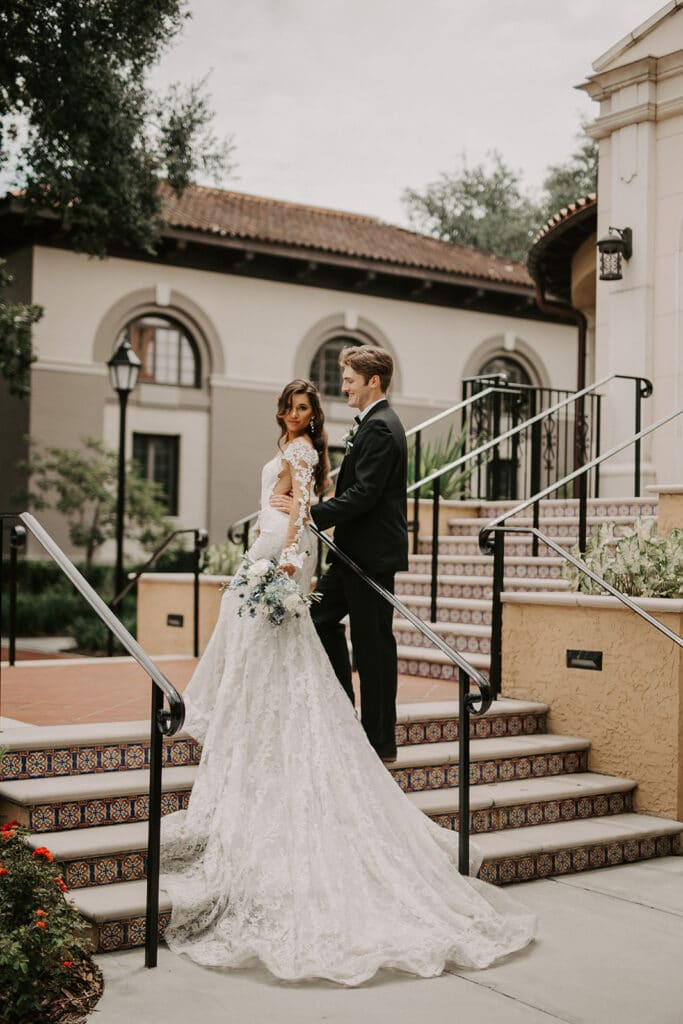 bride and groom at Rollins College steps