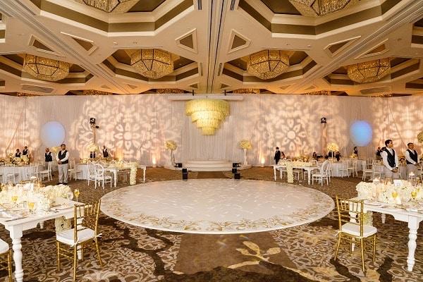 Letz Dance On It - round white wedding dance floor with gold accents