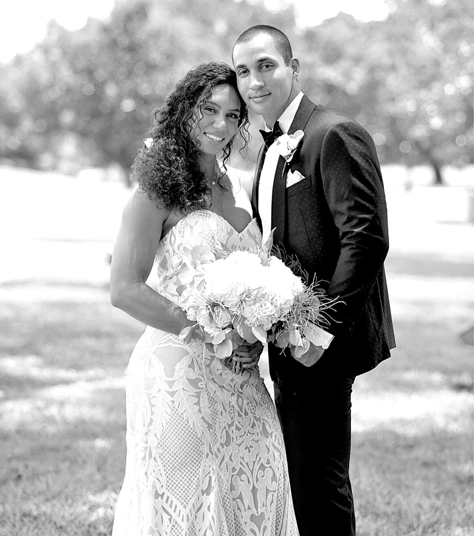 bride and groom with flowers on golf course