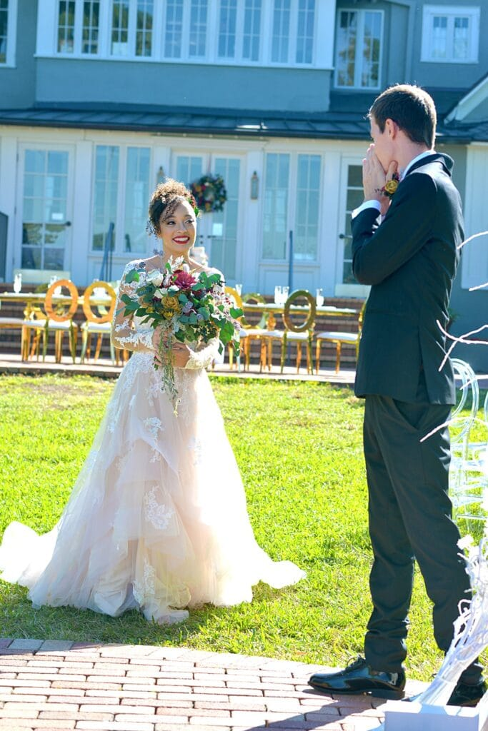 groom covering his mouth as he sees his bride for the first time