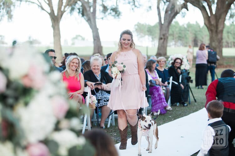 include your pet in your wedding, bridesmaid walking dog down the aisle