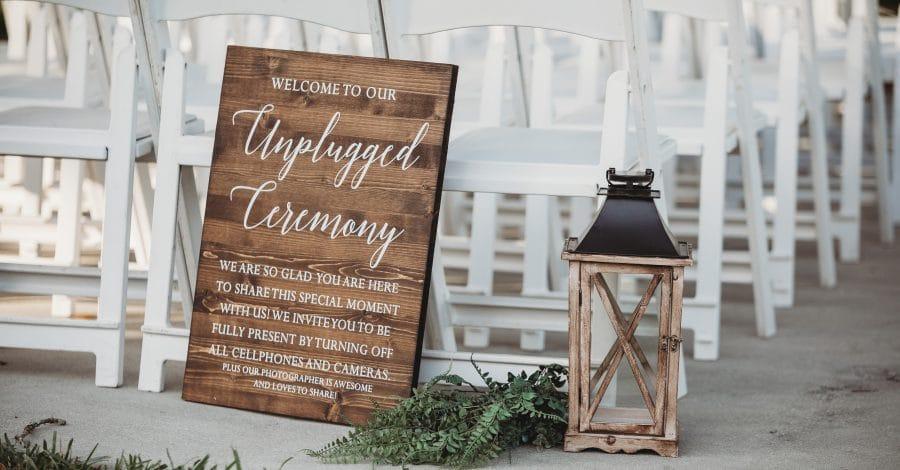Rachel Doyle Photography - Wood Unplugged Ceremony sign at outside wedding