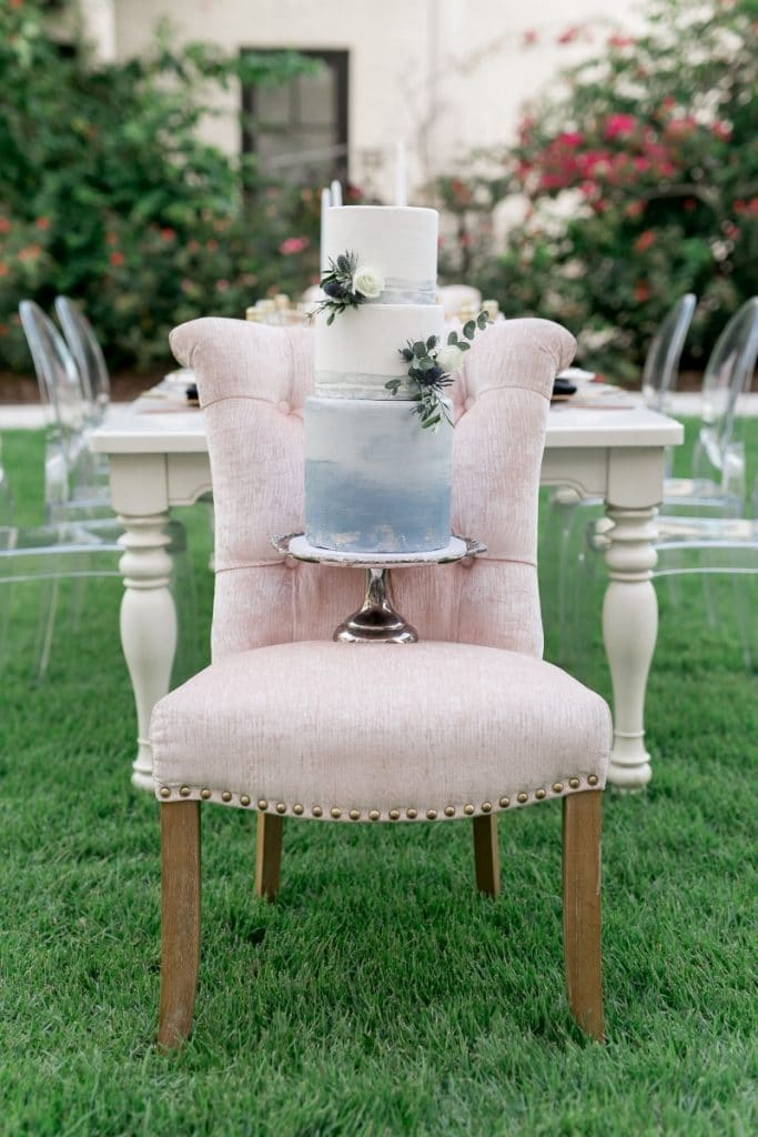 Bake A Wish - wedding cake on chair outside