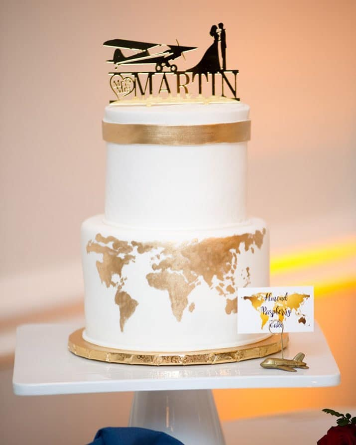 Bake A Wish - airplane wedding cake with gold countries