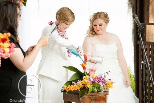 Lee Forrest Design- bride pouring from vases into flower arrangement