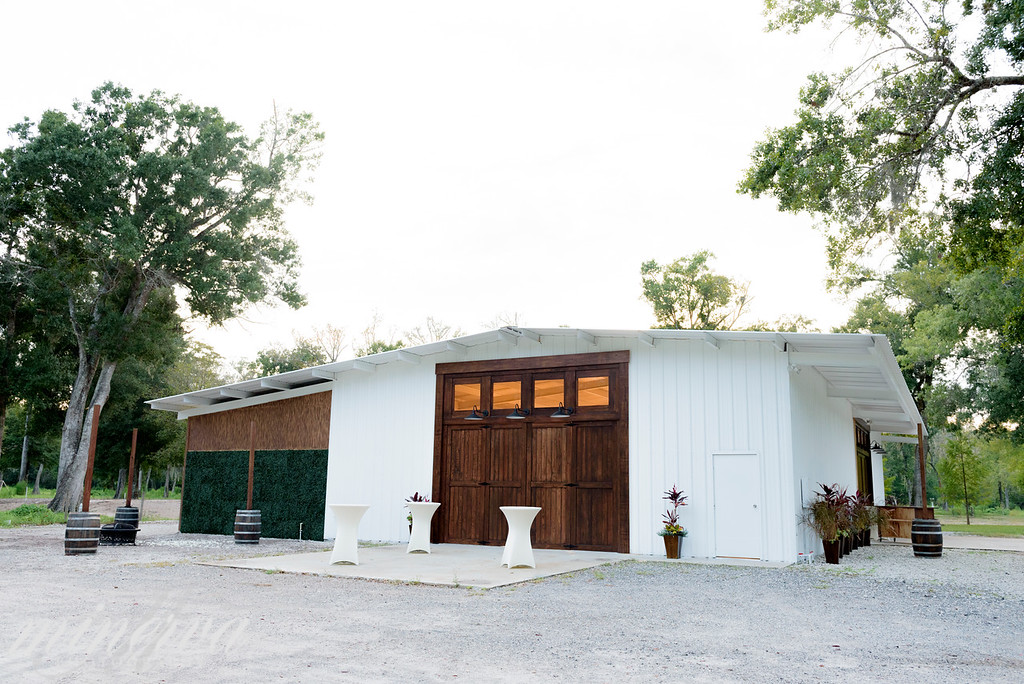 white barn with brown door for weddings