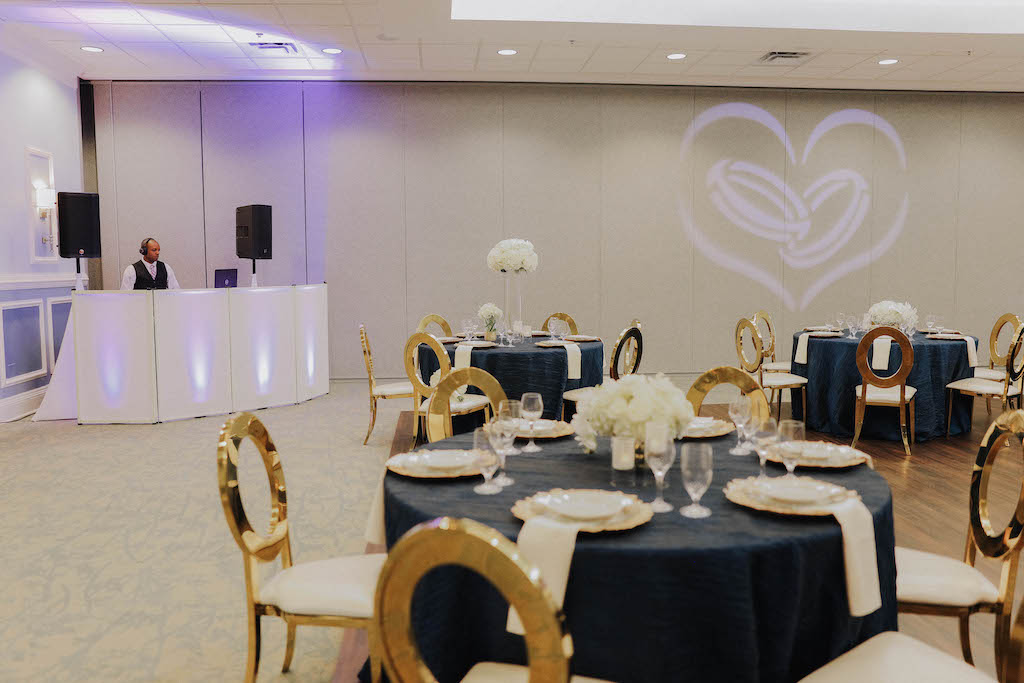 Barney E. Veal Center tables set up for wedding reception with DJ in the corner and image projected onto wall