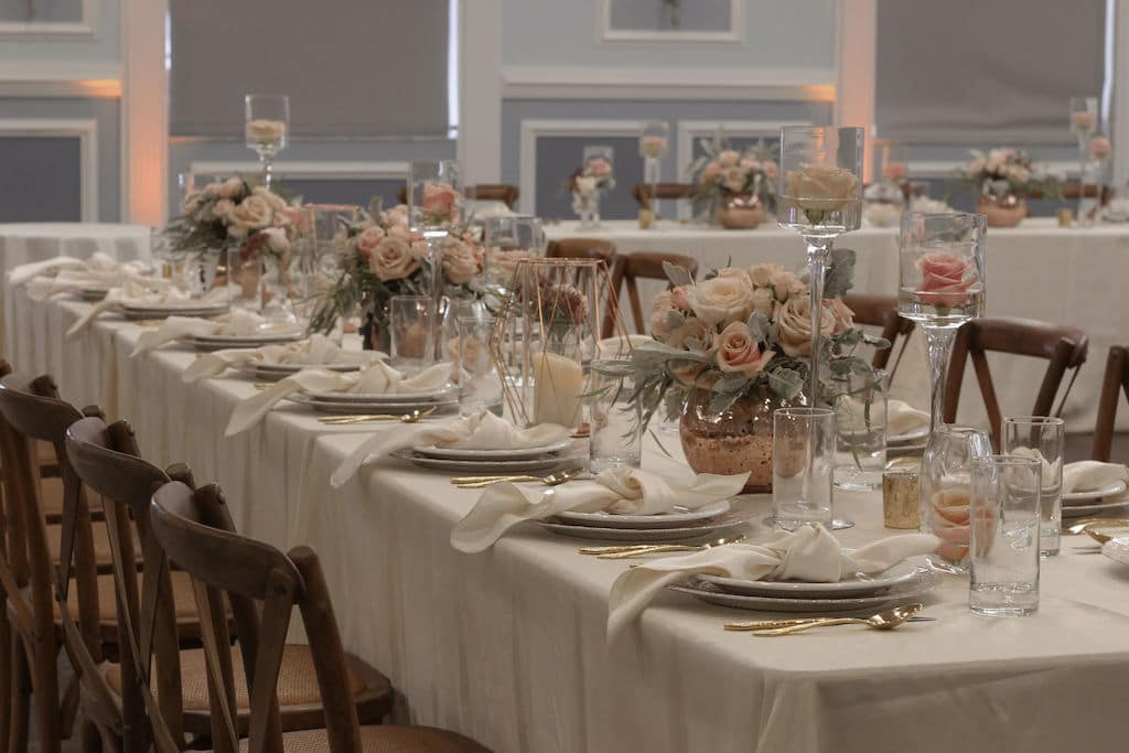Barney E. Veal Center long tables set up for wedding reception with beautiful decorations and flower centerpieces
