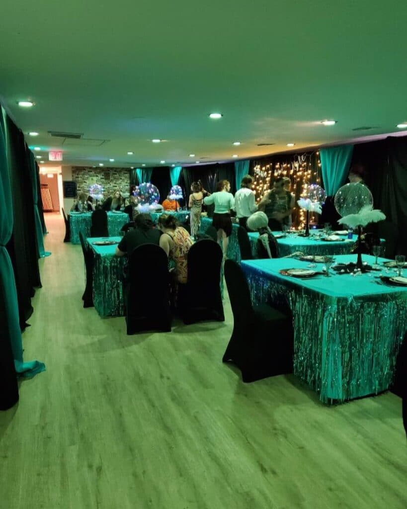 wedding with green lighting and black chairs for halloween