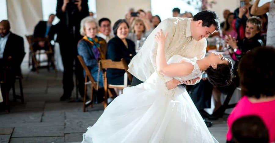Groom dipping bride on dance floor