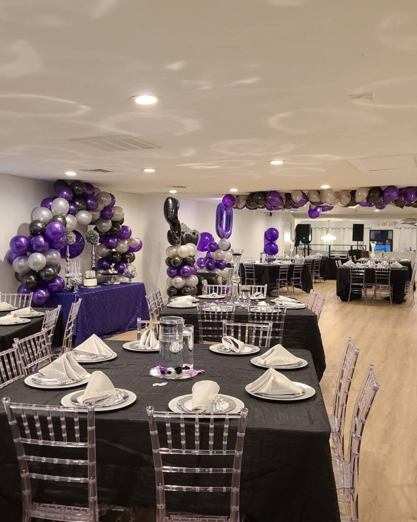 black and purple themed party with silver chairs