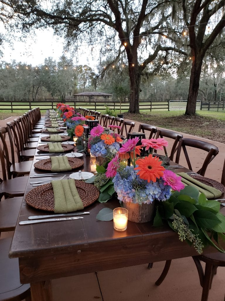 BLB Hacienda, outside long reception table with colorful flowers and candles