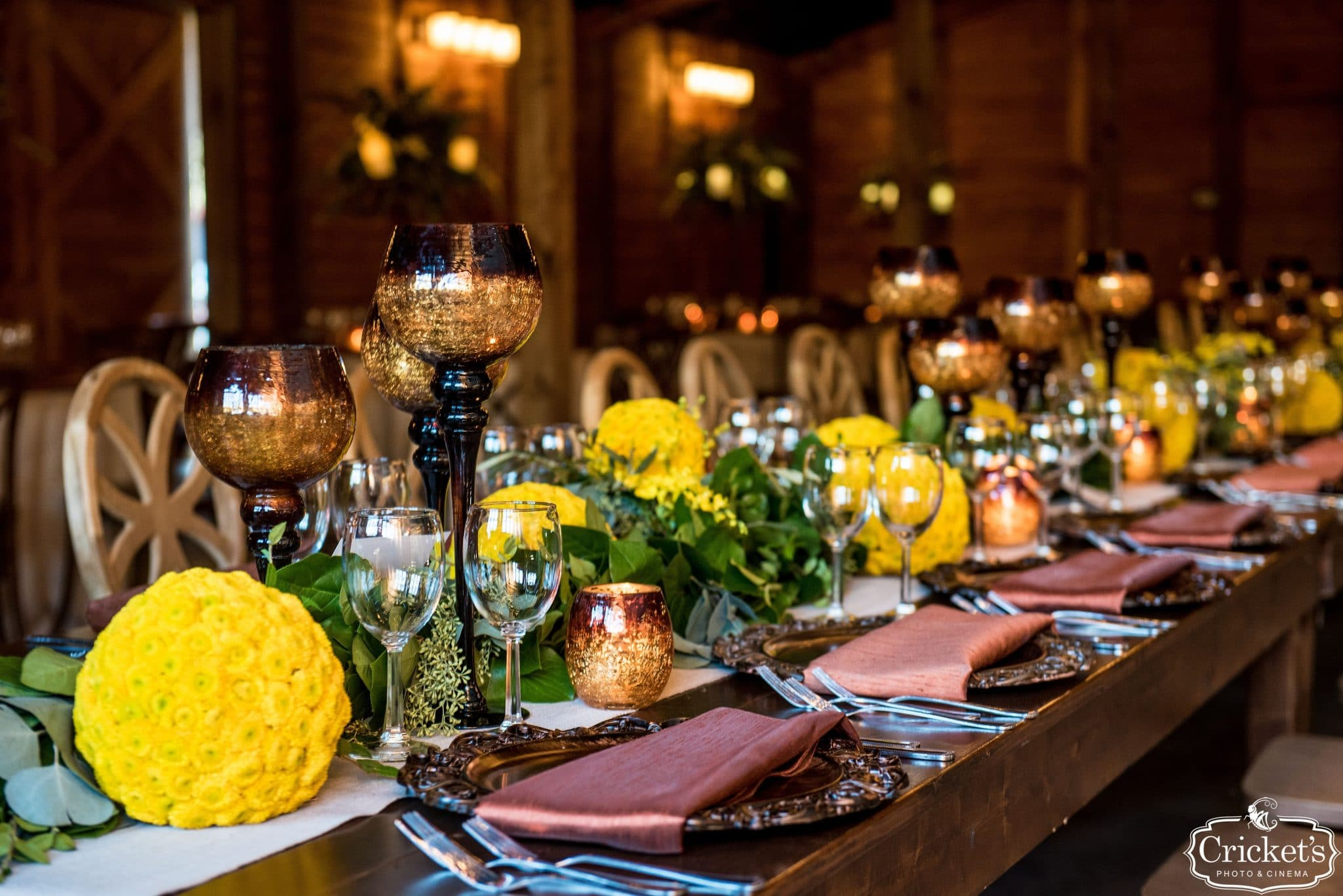 BLB Hacienda, reception dinner with yellow accents and tall candles
