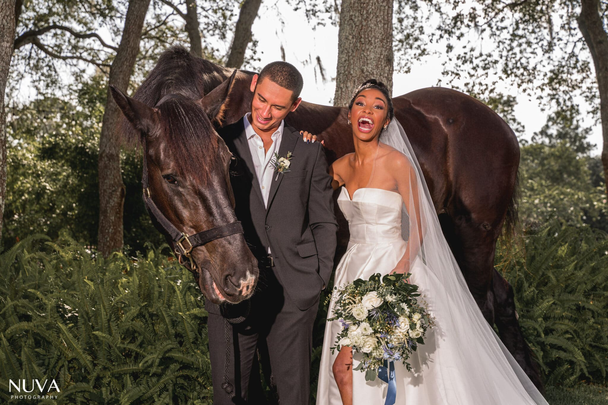 bride and groom laughing with horse