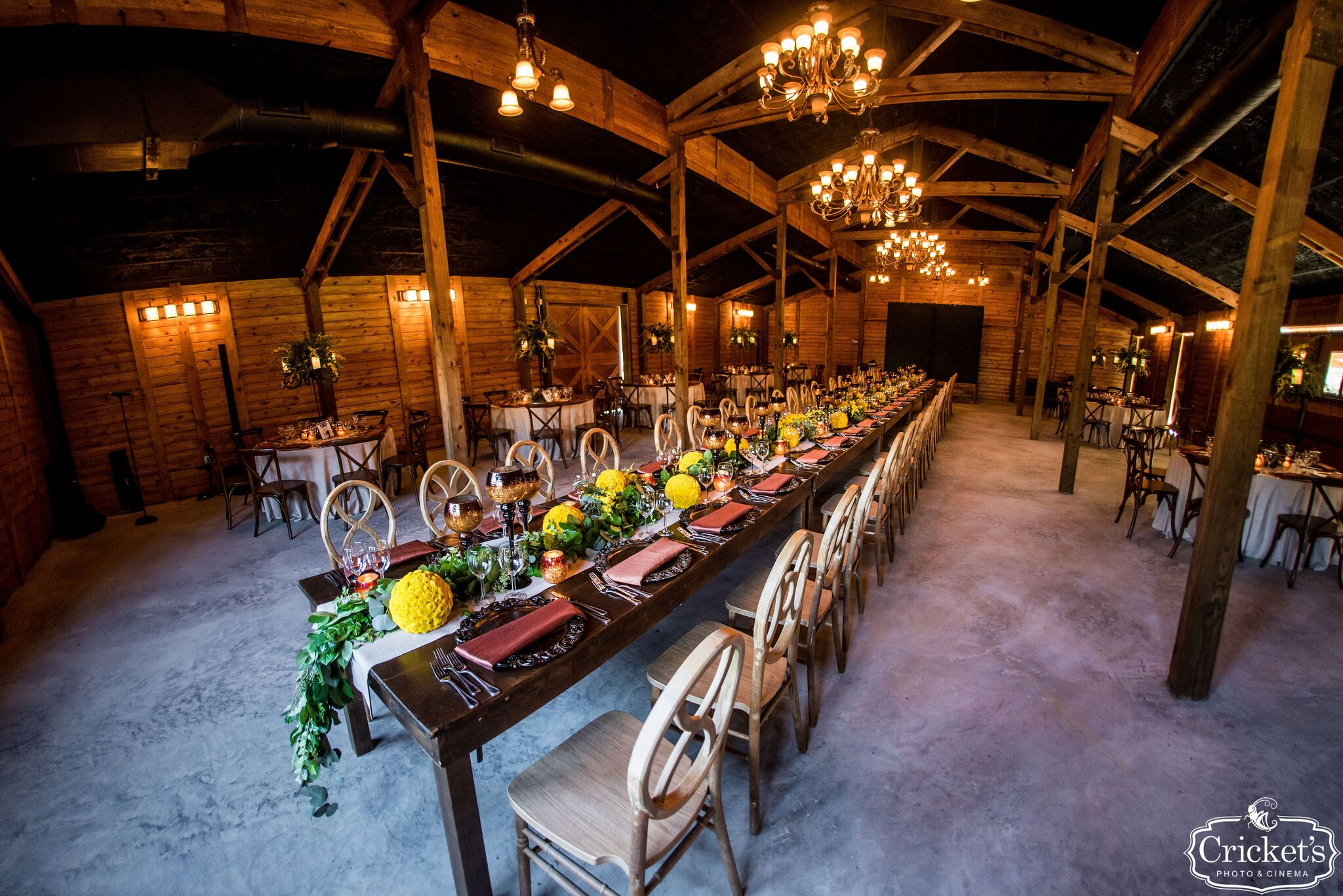 reception barn set up with dining tables