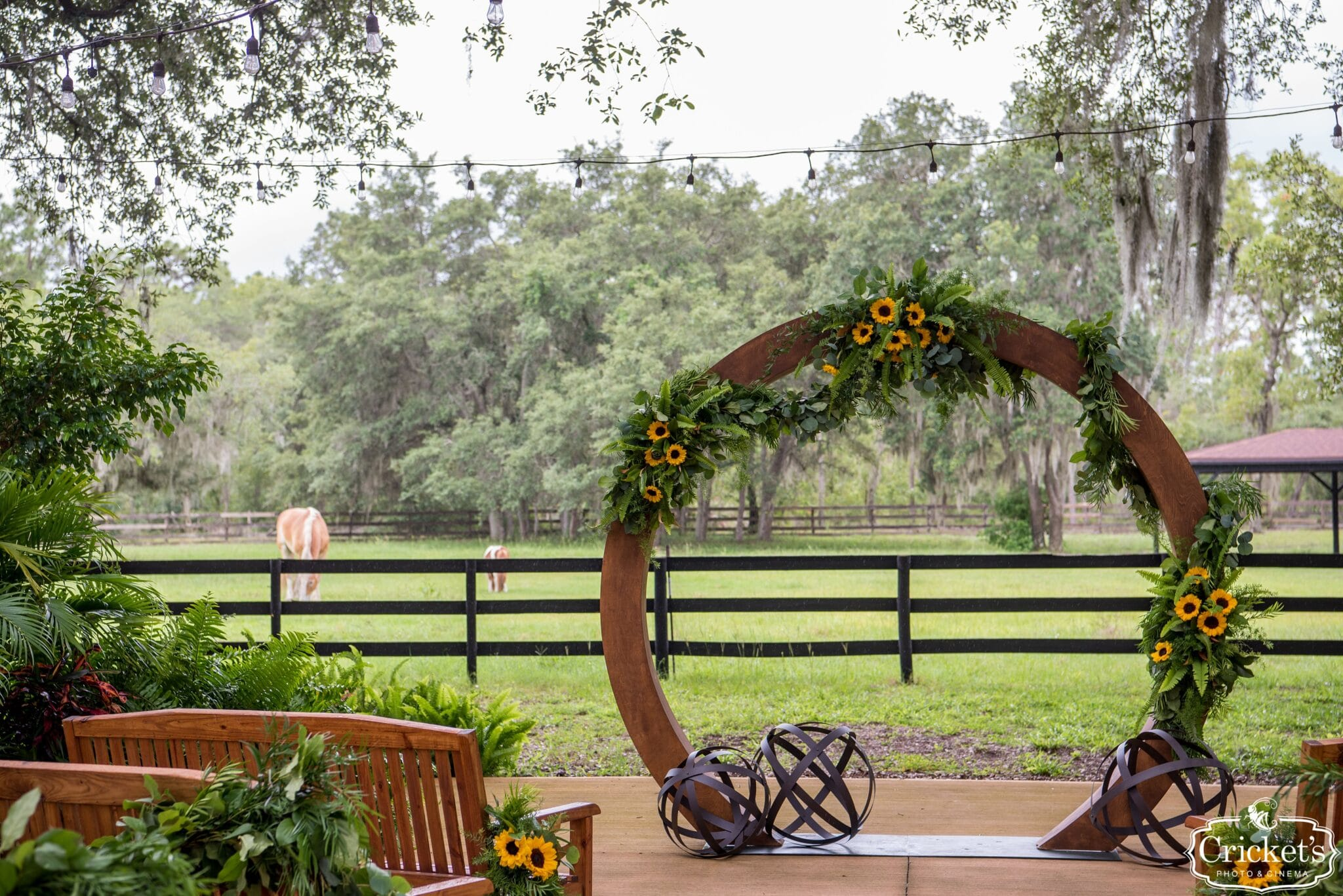 round ceremony arch with flowers