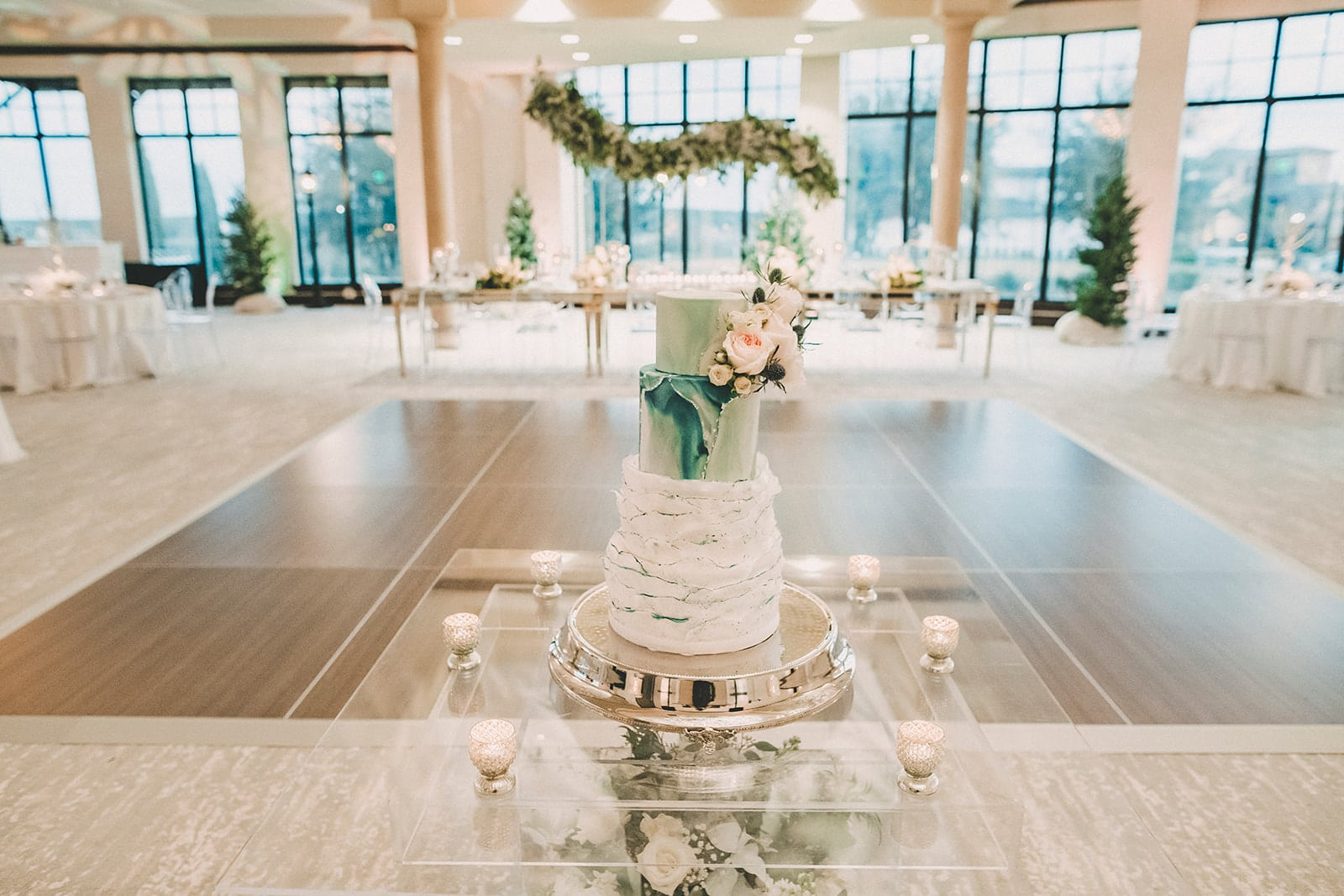 Bella Collina, white wedding reception with cake on glass table