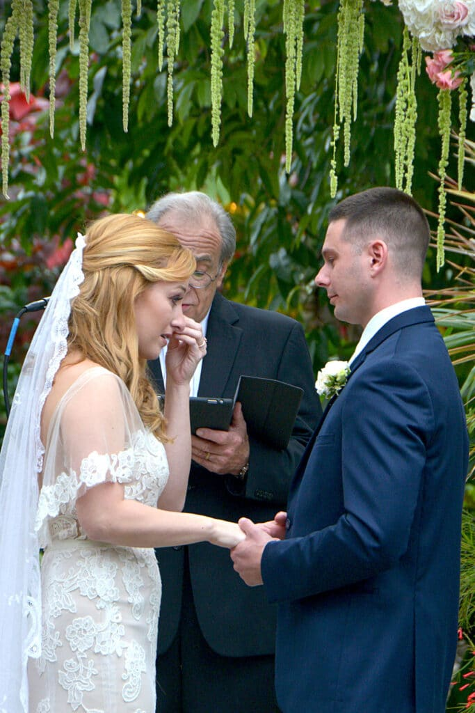 bride getting emotional during vow exchange