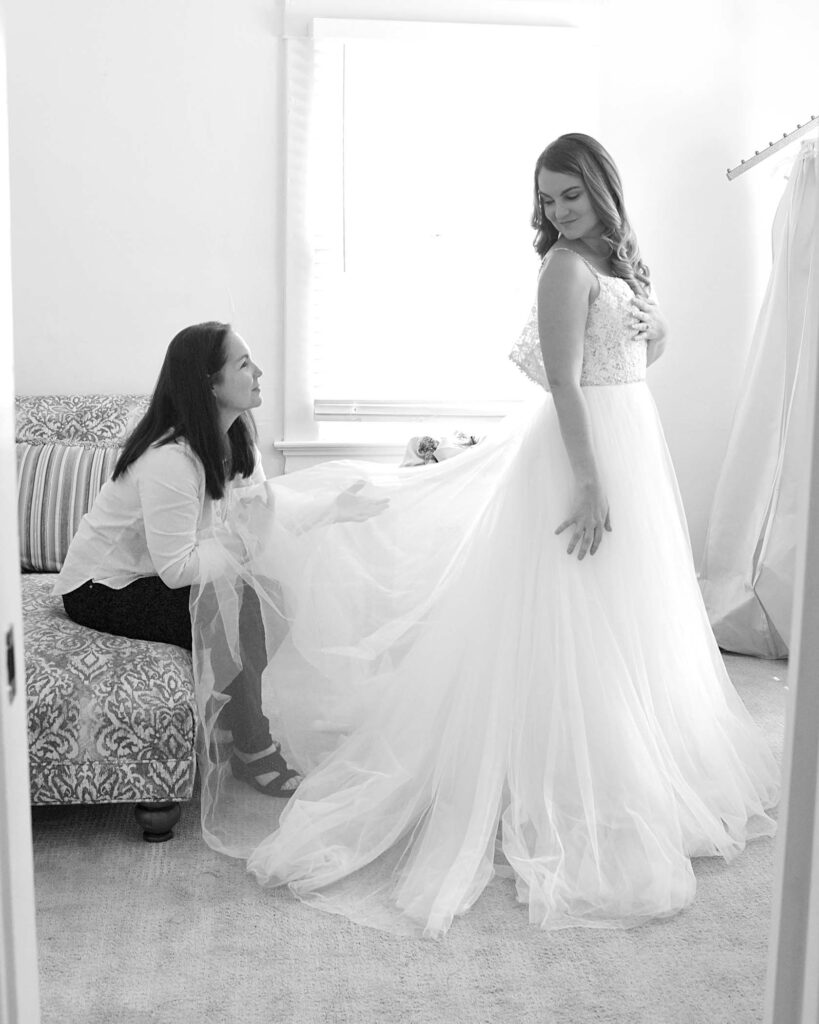 Nadine Nasby Photography, bride getting help with dress