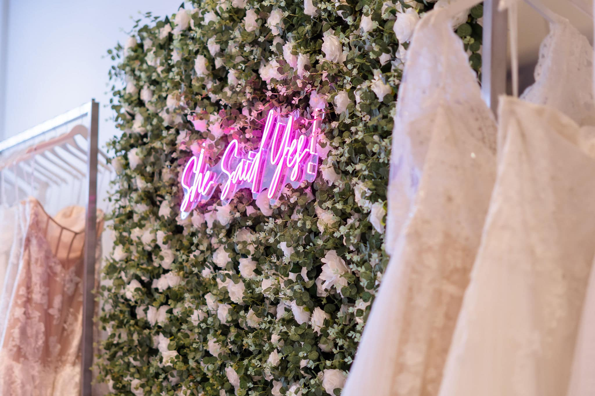 artificial flower wall in orlando with neon sign