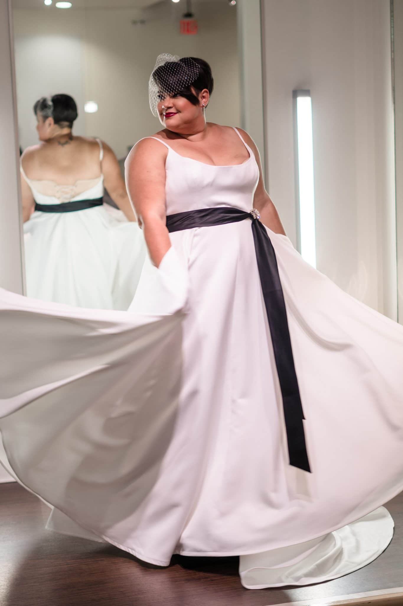 plus size bridal spinning in wedding dress with pockets at solutions bridal