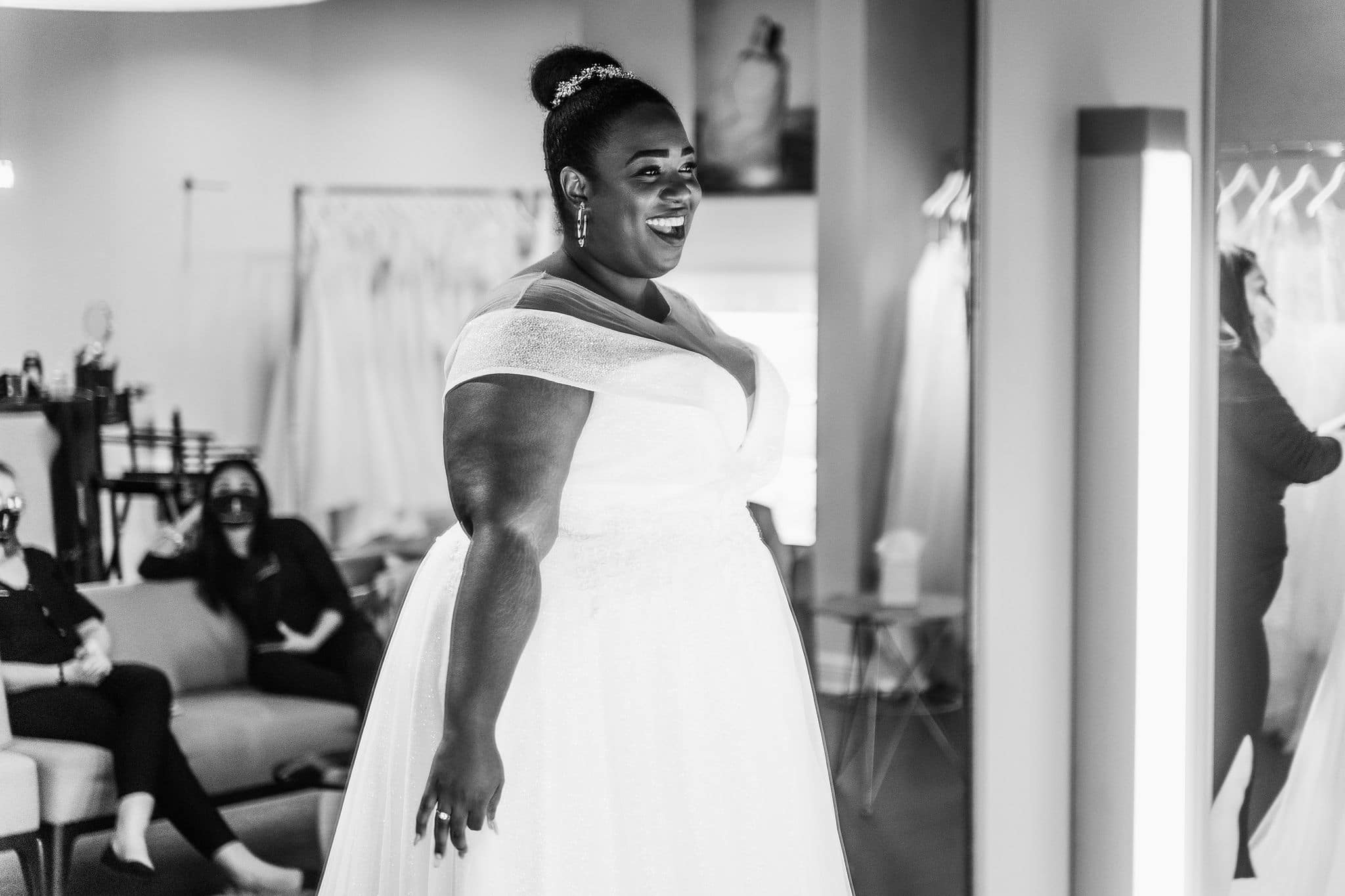 plus size bride in wedding dress grinning ear to ear