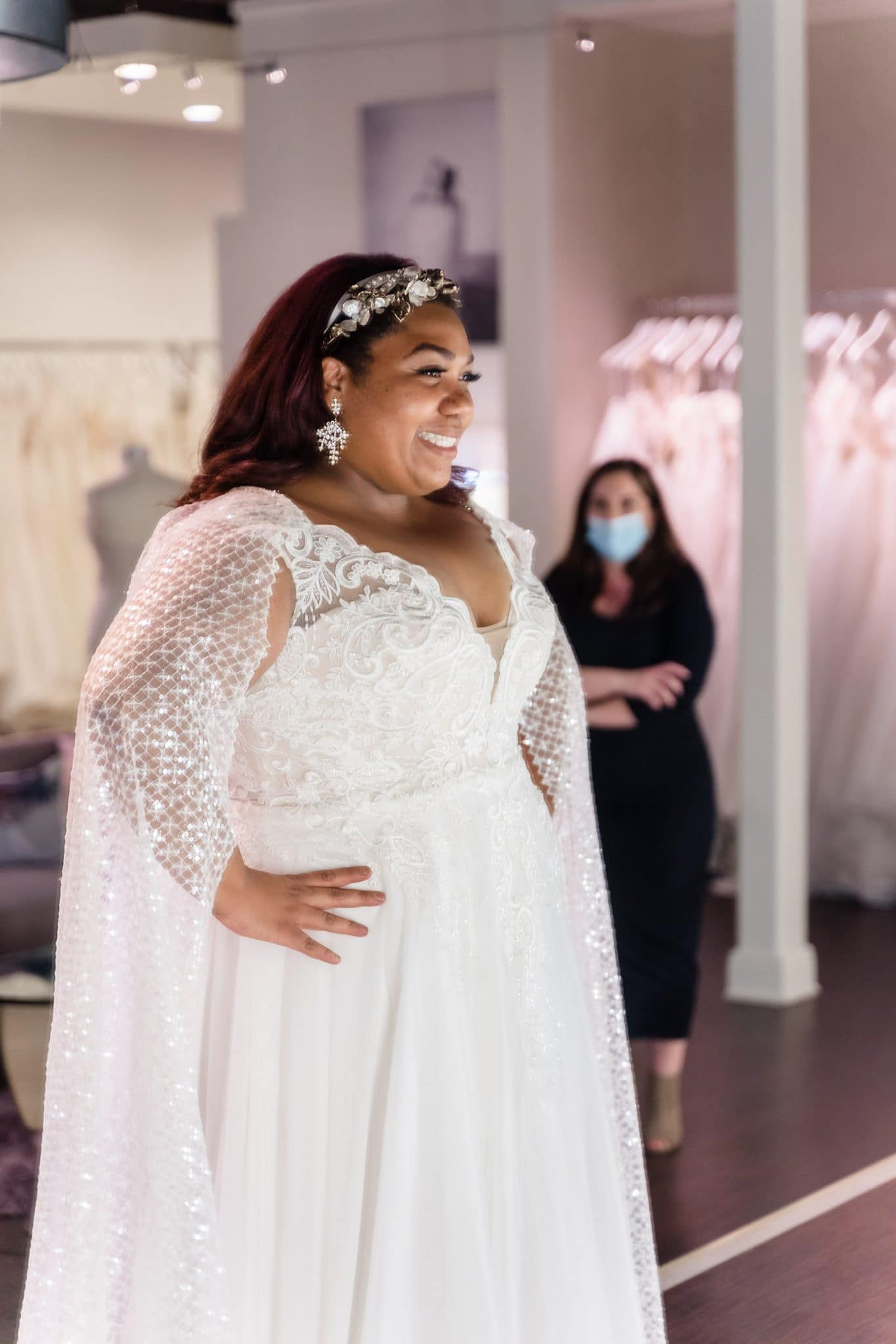 curvy bride in plus size wedding dress with cape