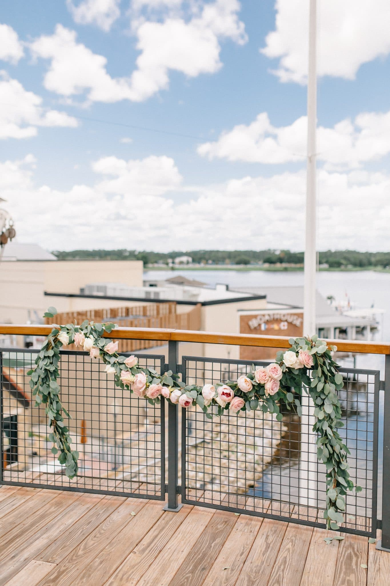 Paddlefish wedding ceremony paddleboat wedding venue roses flower garland