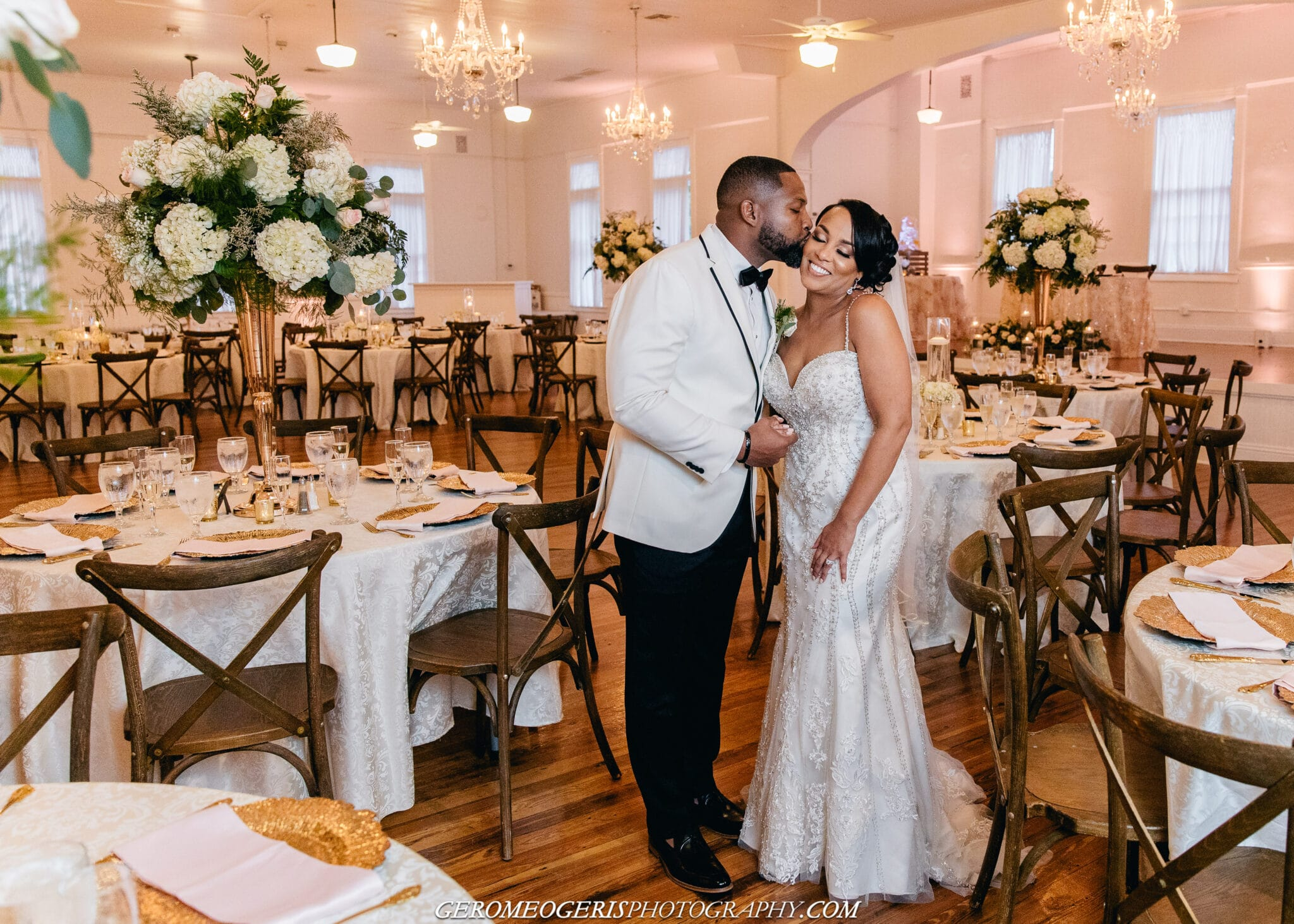 Venue 1902 at Preservation Hall, bride and groom in center of dining room