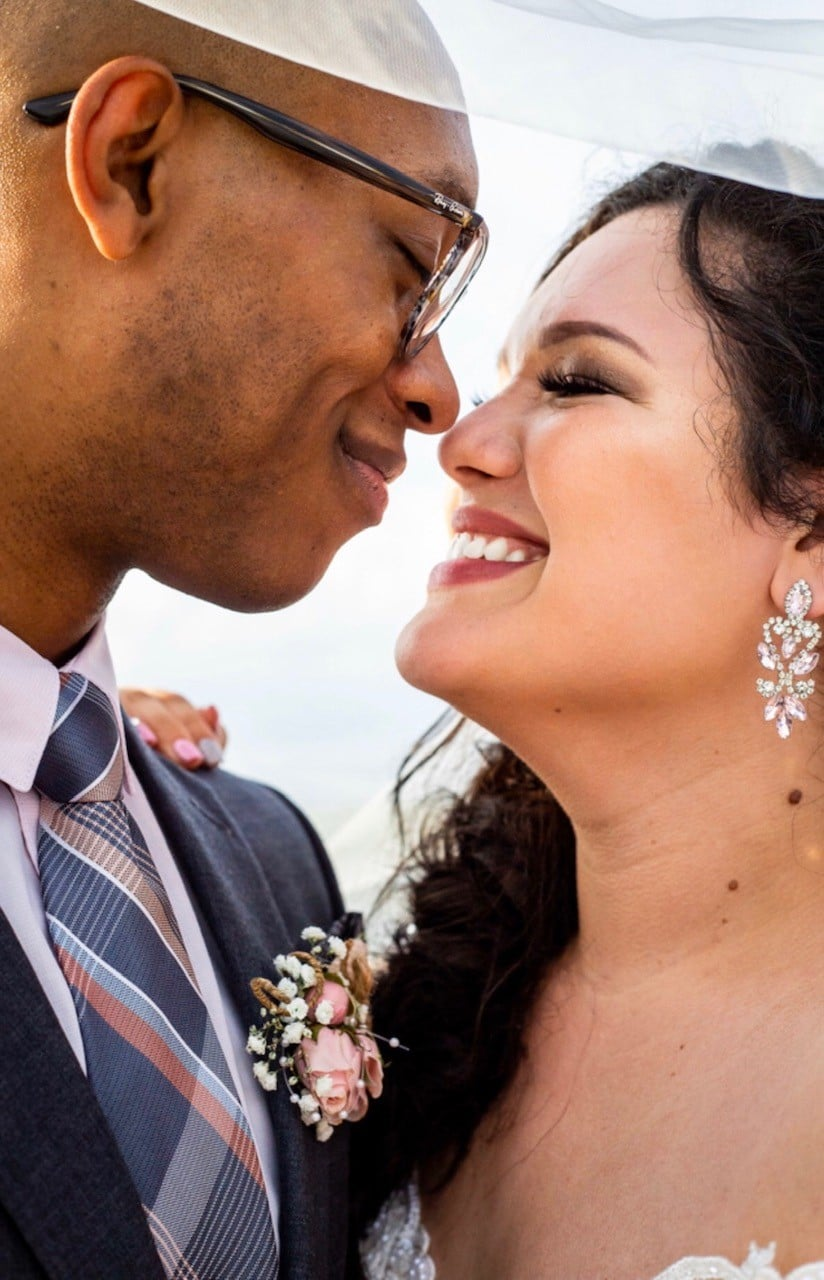With This Ring, close up of bride and groom smiling at each other